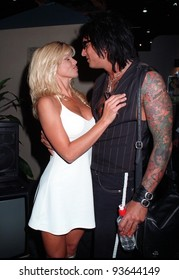 10JUL97:  Baywatch star DONNA D'ERRICO & husband Motley Crue guitarist NICKI SIXX at the Video Software Dealers Assoc. convention in Las Vegas.
