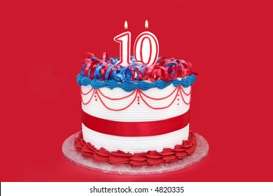 10th cake with numeral candle, on vibrant red background.