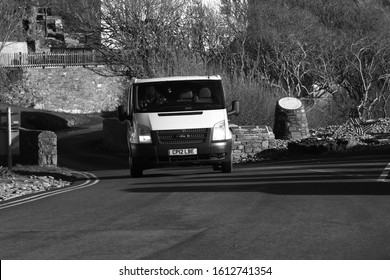 10th January 2020- A Ford Transit 125 T260 van being driven through the village of Amroth, Pembrokeshire, Wales, UK.