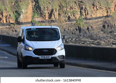10th January 2020- A Ford Transit  Custom 300 van being driven along the coast road at Amroth, Pembrokeshire, Wales, UK.