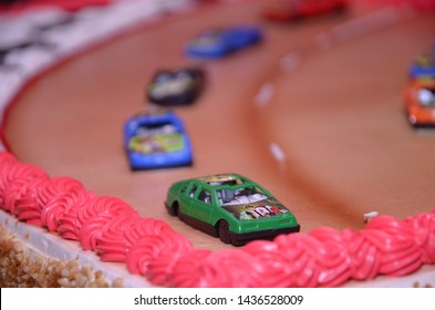 10th June 2019, Kolkata, India: A racing track made on birthday cake of a 1 year old child decorated with Ben ten cars and cream.