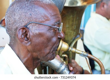 10th of November 2013 - Close up face of black tuba player and mouthpiece of instrument in Remedios, Cuba