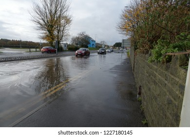 10th November 2018- Cars on a flooded road, after very heavy rain, in the town center at Carmarthen, Carmarthenshire, Wales, UK.