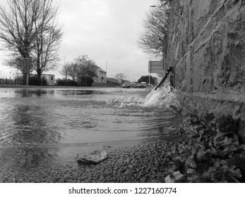 10th November 2018- A road flooded, after very heavy rain, in the town center at Carmarthen, Carmarthenshire, Wales, UK.