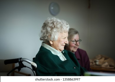 10th October  2016. Lancashire, England. An elderly woman with dementia in a care home visited by relatives