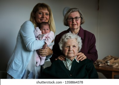 10th October  2016. Lancashire, England. An elderly woman with dementia in a care home visited by relatives and a newborn baby