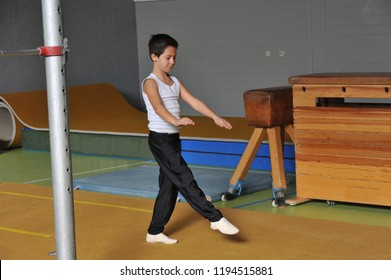 10-Years old Boy in Artistic Gymnastics in floor exercises performs handstand