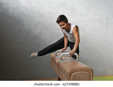 10-Years old Boy in Artistic Gymnastics in exercises on the pommel horse