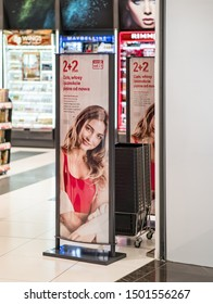 11 Aug 2019, Poznan, Poland, Beauty advertisement on scanner entrance gate for prevent theft in shop or store. Security concept. Shoplifter detector at the drug store in shopping centre.