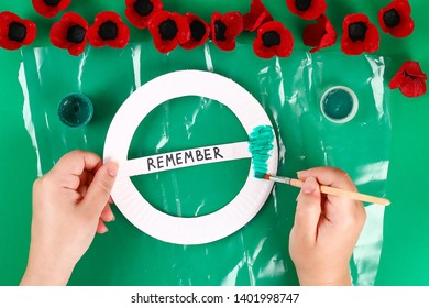 11 Diy wreath red poppy Anzac Day, Remembrance, Remember, Memorial day made of cardboard egg trays on green background. Gift idea, decor. Step by step. Top view. Process kid children craft. Workshop.