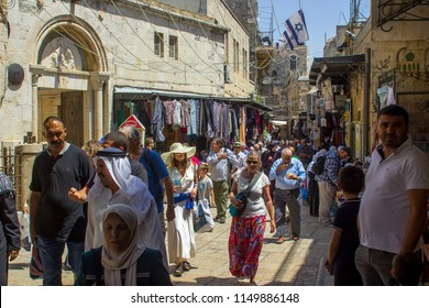 11 May 2018 Crowds of locals and tourists throng the busy Via Dolorosa in the old walled city of Jerusalem Israel on a sunny friday afternoon