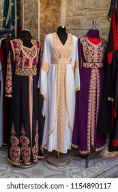 11 May 2018.A small shop window display of full length Muslim Kaftan Gowns in the Old Town Arab bazaar of Jerusalem Israel