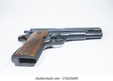 11 mm. Black handgun And ammunition isolated on white