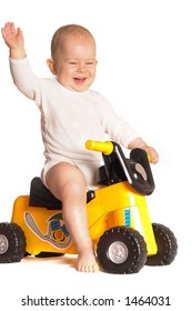 11 moths old baby rides a toy motorbike and he really enjoys it.