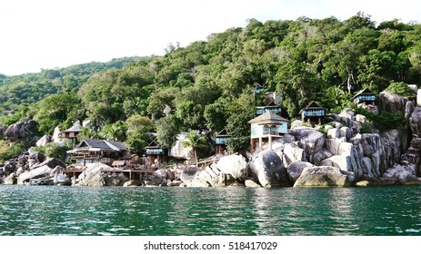 11 NOV 2016 Koh Tao Island,Surat Thani, Thailand view from sea of Mango Bay Boutique Resort . The bungalow build on the rock coast of the island - select focus