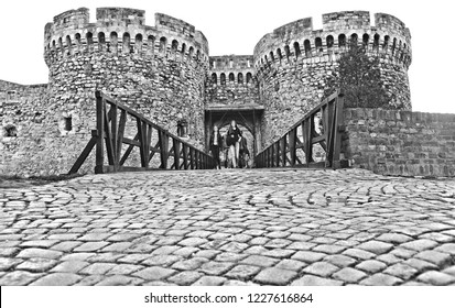 11.04.2018. young people walking in front of one of Kalemegdan fortress castle gates on wooden bridge and stone path in Belgrade Serbia