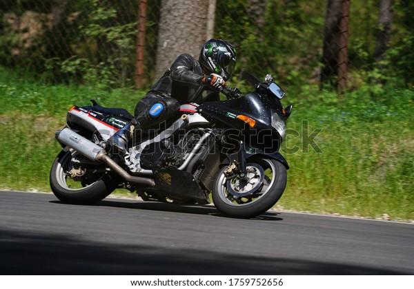 11-05-2020 Riga, Latvia Motorcyclist at sport bike rides by empty asphalt road. sport bike.