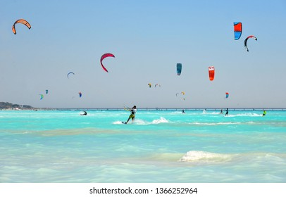 11.06.2017. the paradise beach with a turquoise sea and blue sky and people who practice kit surf in the middle of the waves, Rosignano Livorno, Tuscany Italy, Mediterranean sea. Europe