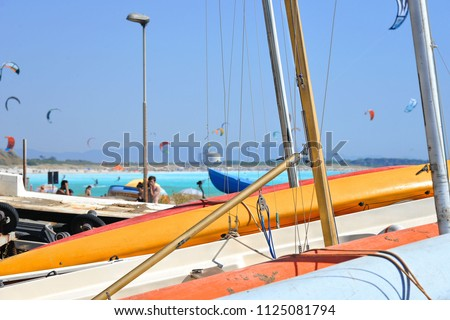 11.06.2017. the paradise beach with a turquoise sea and blue sky and colorful boats on the ground, Rosignano Livorno, Italy