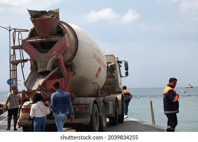 11-09-2021 Istanbul-Turkey: Cement truck working on the beach