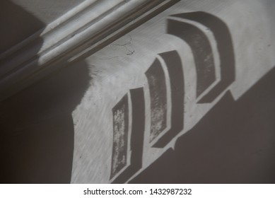 111: the numerals one, one, one are projected from the glass above a front door of a 1930's house on to the original plaster corniche of a north London house