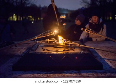 11.11.2018. RIGA, LATVIA. People light wooden torch, in Riga , during Lāčplēsis Day - memorial day for soldiers who fought for the independence of Latvia.