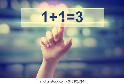 1+1=3 concept with hand pressing a button on blurred abstract background
