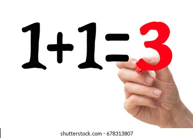 "1+1=3 concept with hand writing down the number ""3"" in red marker pen."
