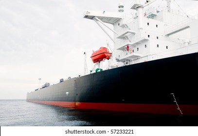 115,000 ton oil-tanker moored offshore.