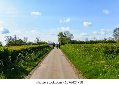 11/5/19 - Two people on horse on a rural lane in Northamptonshire - Woodend, UK