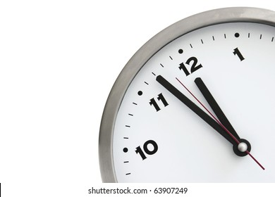 11:57 on the white wall clocks (isolated)