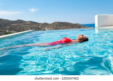 11-6-2016 Ios island, Greece, woman enjoys her holidays in the water pool