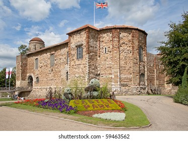 11th century Norman castle in Colchester in springtime and UK flag.