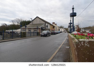 11th January 2019- The main street, with parked vehicles, in the small town of St Clears, Carmarthenshire, Wales, UK.