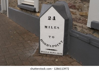11th January 2019- An old mileage sign, made by the Moss & Sons, on the main road in the town center, at St Clear, Carmarthenshire, Wales, UK.