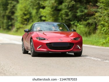 11th July, 2018, Transfagarasan, Romania - a red Mazda MX-5 driving at leisure speed