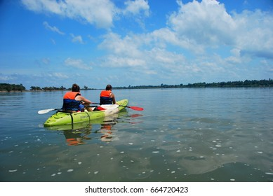 11TH MAY 2014, DON DET, LAOS - Tourists on a kayaking tour on the Mekong River looking for pink dolphins near Don Det, 4000 Islands, Laos