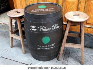 11th September 2019, Dublin, Ireland. The Palace Bar Green Spot single pot still Irish whiskey barrel with two wooden stools outside the Palace Bar on Fleet Street, Temple Bar.