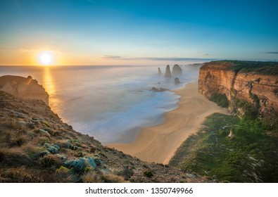 The 12 Apostles at sunset, near Port Campbell, Shipwreck Coast, Great Ocean Road, Victoria, Australia.