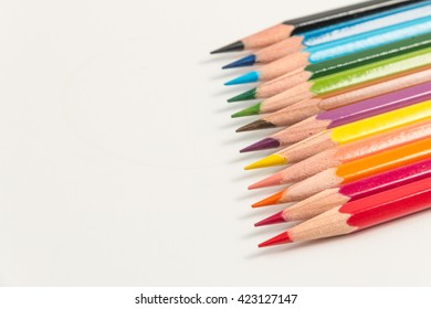 12 color pencils on white background