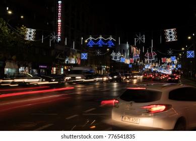 12 DEC 2018, Boulevard Nicolae Balcescuin, Bucharest, capital city of Romania. Beautiful Christmas decoration with traditional patterns. Festive spirit, night traffic. Long exposure
