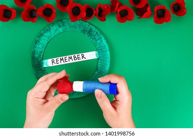 12 Diy wreath red poppy Anzac Day, Remembrance, Remember, Memorial day made of cardboard egg trays on green background. Gift idea, decor. Step by step. Top view. Process kid children craft. Workshop.