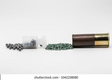 12 gauge cartridge. Gunpowder, block and perdigon on white background