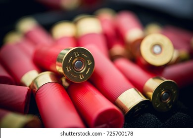 12 gauge red hunting cartridges for shotgun on black color background