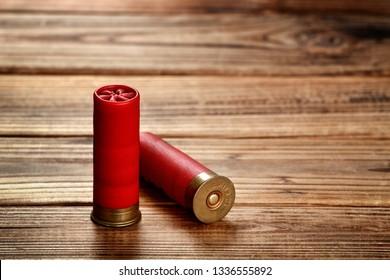 12 gauge shotgun shells on wood.