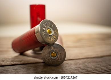 12 gauge shotgun shells on a wooden plank used for 12 gauge shotguns often in sporting clays or skeet shooting