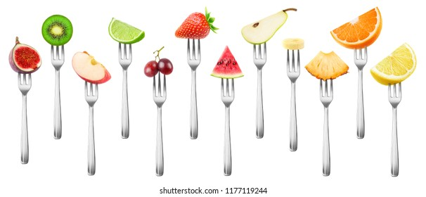 12 isolated fruit pieces. Cut fig, apple, kiwi, lemon, grape, orange, lime, strawberry, watermelon, banana, pineapple and pear on a steel dessert fork isolated on white background with clipping path