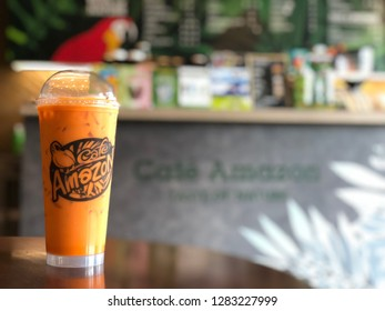 12 Jan 2019; Bangkok Thailand: Cup of Thai Milk Tea at Cafe Amazon, Coffee shop