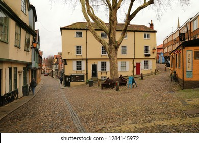 12 January 2019 - 12:15 - Norwich, Norfolk in England. Elm Hill is an historic cobbled lane in Norwich, Norfolk with many buildings dating back to the Tudor period.