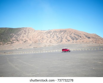 """""""12 July 2017,bromo indonesia"""" red jeep car on desert"""